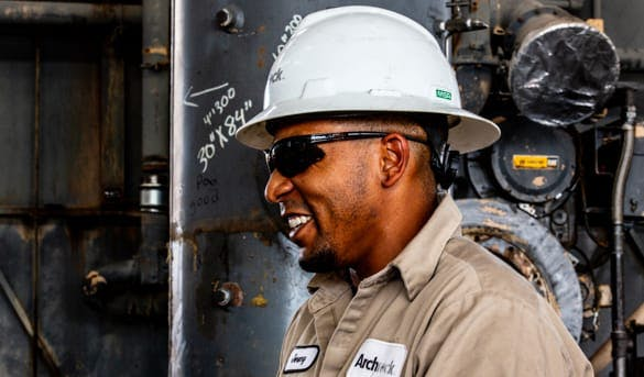 Worker in sunglasses smiling